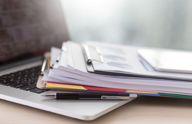 bigstock-Businessman-Working-Reading-Do-750px